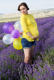 Beautiful pregnant woman in the lavender field Royalty Free Stock Photography