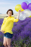 Beautiful pregnant woman in the lavender field Royalty Free Stock Photo