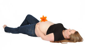Beautiful pregnant woman laying on back Stock Image