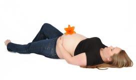 Beautiful pregnant woman laying on back Stock Image