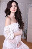 Beautiful pregnant woman with long dark hair wearing lace dress Stock Images
