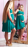 Beautiful pregnant woman. With long hair near a mirror royalty free stock images