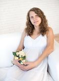 Beautiful pregnant woman looking at her belly Stock Images