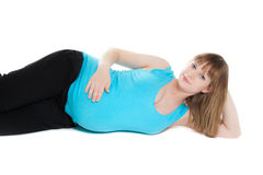 Beautiful pregnant woman looking to the camera Stock Photography