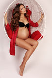 Beautiful pregnant woman with luxurious dark hair Stock Photography