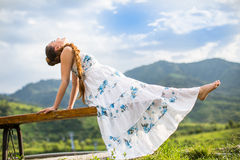 Beautiful pregnant woman meditating on nature Stock Images