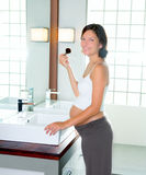 Beautiful pregnant woman on modern bathroom makeup Stock Photos