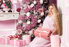 Beautiful pregnant woman. Near the Christmas tree royalty free stock photos