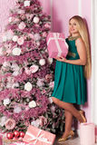 Beautiful pregnant woman. Near the Christmas tree stock photography