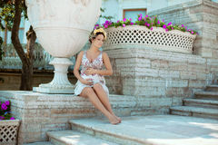 Beautiful pregnant woman near the palace Stock Images