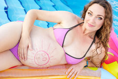 Beautiful pregnant woman near pool Royalty Free Stock Photography