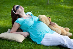 Beautiful Pregnant Woman On Green Grass Royalty Free Stock Image