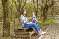 Beautiful pregnant woman outdoor with her little boy Royalty Free Stock Photo