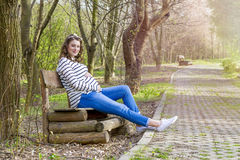 Beautiful pregnant woman outdoor in the park Stock Image
