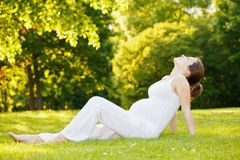 Beautiful pregnant woman in the park Royalty Free Stock Images