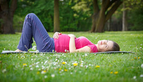 Beautiful pregnant woman in the park Stock Photo