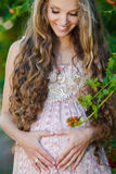 Beautiful pregnant woman in the park Stock Images