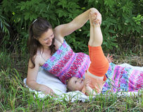 Beautiful pregnant woman playing with her ​​little daughter Royalty Free Stock Photos