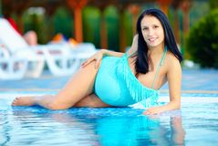 Beautiful pregnant woman posing near the pool Stock Image