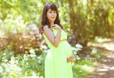Beautiful pregnant woman posing Stock Photo
