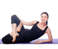 Beautiful pregnant woman practicing yoga Royalty Free Stock Image