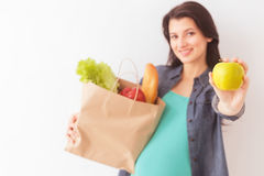 Beautiful pregnant woman prefers healthy eating Stock Images