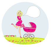 Beautiful pregnant woman pushing a stroller Royalty Free Stock Photography