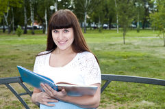 Beautiful pregnant woman read book in the park Stock Photos