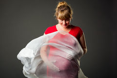 Beautiful pregnant woman in red dress Royalty Free Stock Photography