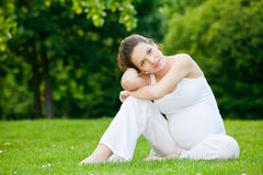 Beautiful pregnant woman relaxing. In the park Royalty Free Stock Photography