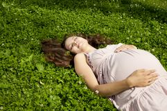 Beautiful pregnant woman relaxing in the park Royalty Free Stock Images
