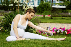 Beautiful pregnant woman relaxing in the park. Beautiful pregnant woman doing sport in park Stock Photography