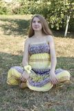 Beautiful pregnant woman relaxing in the park Royalty Free Stock Photos