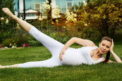 Beautiful pregnant woman relaxing in the park Royalty Free Stock Image
