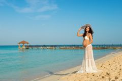 Beautiful pregnant woman on a sandy beach. Dominican Republic, the Caribbean Sea. Royalty Free Stock Photos