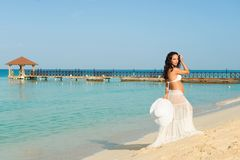 Beautiful pregnant woman on a sandy beach. Dominican Republic, the Caribbean Sea. Stock Images