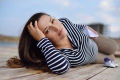 Beautiful pregnant woman on the sea coast Stock Photo