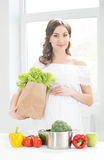 Beautiful pregnant woman with a shopping bag Stock Photo