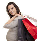Beautiful pregnant woman with shopping bags Royalty Free Stock Image