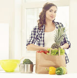 Beautiful pregnant woman with shopping bags in kitchen. Motherho Royalty Free Stock Image