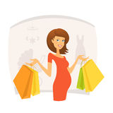 Beautiful pregnant woman with shopping bags Royalty Free Stock Images