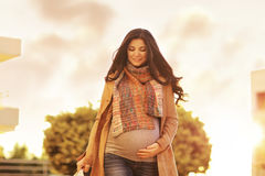 Beautiful pregnant woman with shopping bags stock photos
