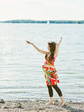Beautiful pregnant woman and shore Royalty Free Stock Photo