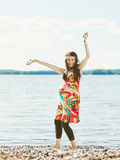 Beautiful pregnant woman and shore Royalty Free Stock Image
