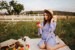 Beautiful pregnant woman show and eat red apple. Healthy food. Fresh fruits. Happy woman smile.  stock images