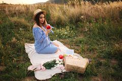 Beautiful pregnant woman show and eat red apple. Healthy food. Fresh fruits. Happy woman smile.  stock image