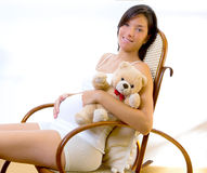 Beautiful pregnant woman sitting teddy bear Royalty Free Stock Photography
