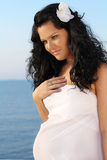 Beautiful  pregnant woman on sky background Stock Photo