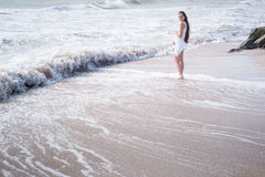 Beautiful pregnant woman stand on the sea shore Stock Images