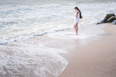 Beautiful pregnant woman stand on the sea shore Royalty Free Stock Image